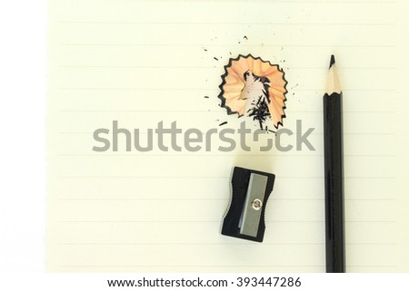 pencils , sharpener shave black drawing on paper note background - stock photo