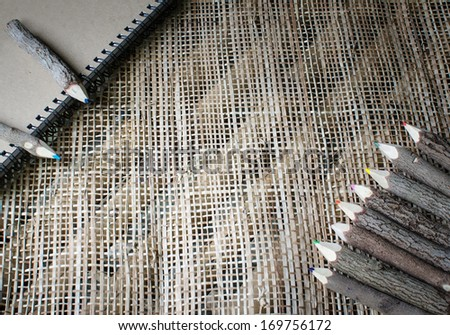 pencils stylized tree branch on fiber wave  background - stock photo