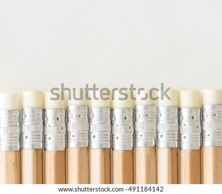 Pencils with eraser side up, on white background with copy-space.
