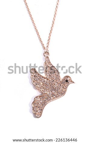 pendant with a gold dove on white background - stock photo