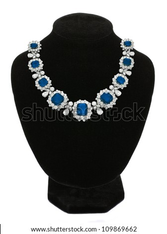 Pendant with blue gem stones on black mannequin isolated on white - stock photo