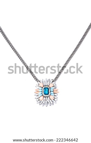 pendant with flower and blue gem  on a white background - stock photo