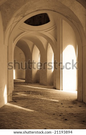 penetration of light in the old passage - stock photo