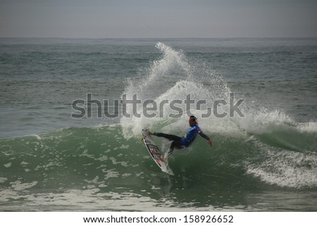 PENICHE, PORTUGAL - 2013 OCT 17: Jordy Smith layback snap in Quarters, heat 3 at WCT contest, Moche Rip Curl Pro Peniche, Portugal 17 October 2013 - stock photo