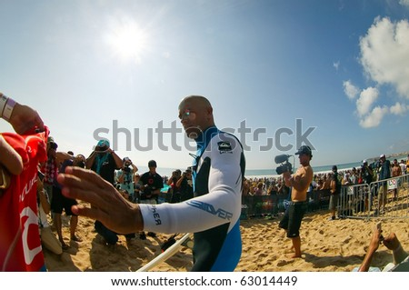 PENICHE, PORTUGAL - OCTOBER 14 : Kelly Slater (USA) in Rip Curl Pro 2010 Quarters Final  October 14, 2010 in Peniche, Portugal - stock photo