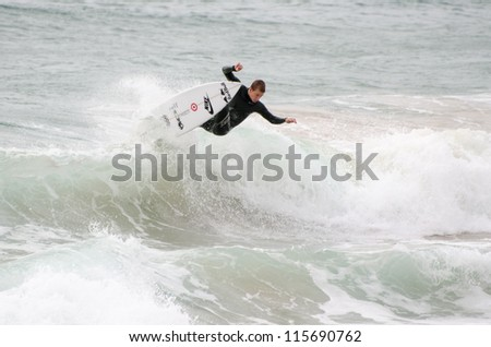 PENICHE, PORTUGAL - OCTOBER 14 : Unidentified surfer practicing during the Rip Curl Pro Portugal, October 14, 2012 in Peniche, Portugal - stock photo