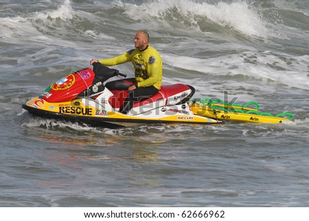 PENICHE, PORTUGAL - OCTOBER 9: Unidentified water patrol officer patrols the waters by The 3rd Rip Curl Women Pro Portugal, October 9, 2010 in Peniche, Portugal - stock photo