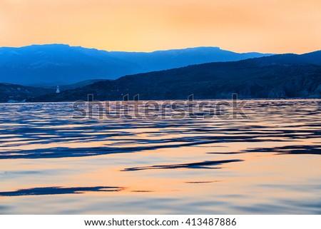 peninsula of Crimea coastline on sunset in summer - stock photo