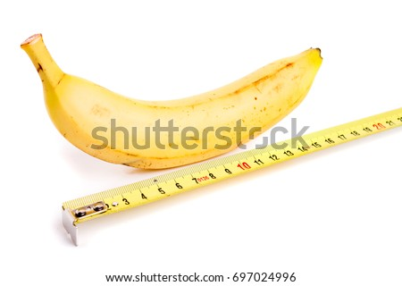 penis concept ripen yellow banana measured by measurement tape comparable to man penis size