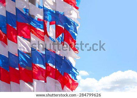 pennant in the colors of the Russian flag and the sunny sky