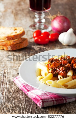 penne bolognese and parmigiano cheese - stock photo