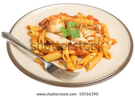 Penne pasta with chicken breast in tomato sauce. - stock photo