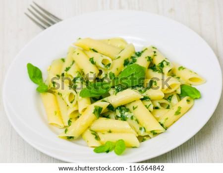 penne pasta with pesto sauce - stock photo