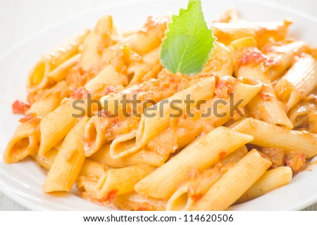 Penne pasta with tomato sauce - stock photo