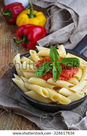Penne pasta with tomato sauce. Selective focus - stock photo