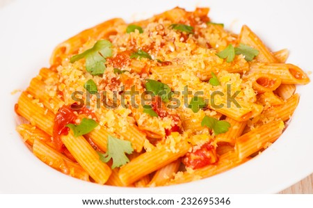 Penne rigate pasta with tomato sauce - stock photo