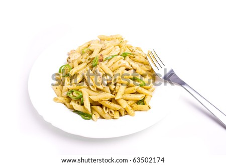 Penne with basil, olive oil and pine dressing - stock photo