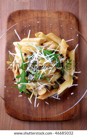 Penne with pickled peppercorns, capers and lemon scent - stock photo