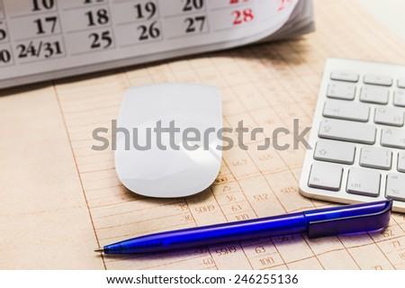 Pens, calendars and computer keyboard - stock photo