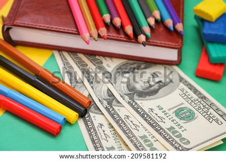 Pens, colored pencils, plasticine, book, hundred dollar bills - stock photo
