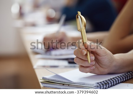 pens, notebooks, training, close-up, people learn and record the acquired knowledge