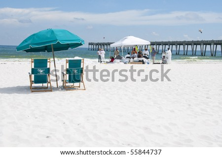 PENSACOLA BEACH - JUNE 23: Beach chairs lie empty on June 23, 2010 in Pensacola Beach, FL. - stock photo