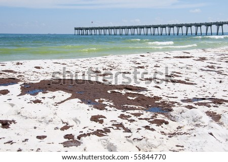 PENSACOLA BEACH - JUNE 23:  Oil covered sand is shown on June 23, 2010 in Pensacola Beach, FL - stock photo