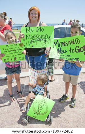 "PENSACOLA, FL - 25 MAY: Protesters rally in Pensacola, FL on May 25, 2013 in support of the worldwide ""March Against Monsanto"" rallies to protest the safety and non-labeling of GMO foods."