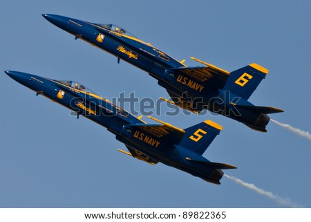 PENSACOLA, FL - NOVEMBER 11: The US Navy Blue Angels in F-18 Hornet planes perform in air show routine in Pensacola, FL on November 11, 2011. The Blue Angels are the oldest active aerobatic team in the world. - stock photo