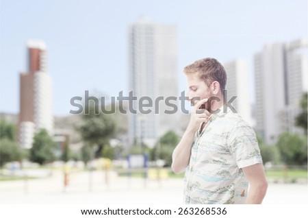 pensative ginger young man with hawaiian shirt - stock photo