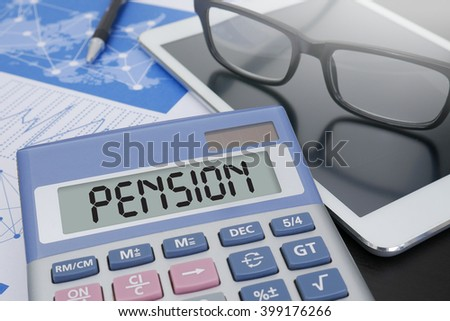 PENSION Calculator  on table with Office Supplies. ipad - stock photo