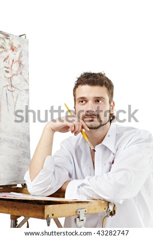 Pensive artist invents a new image. Isolated over white - stock photo