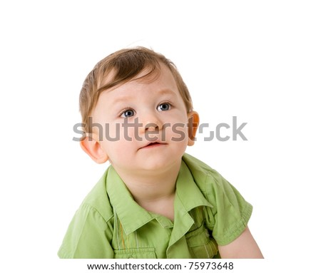 Pensive Boy one year age looking aside isolated on white - stock photo