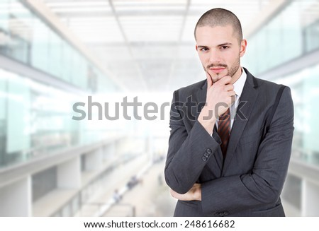pensive business man thinking at the office - stock photo