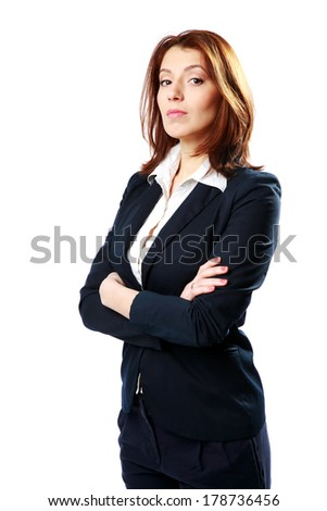 Pensive businesswoman standing with arms folded isolated on a white background - stock photo