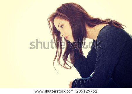 Pensive casual woman touching her head - stock photo