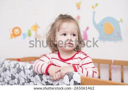 pensive child in bed don't want to sleep  - stock photo
