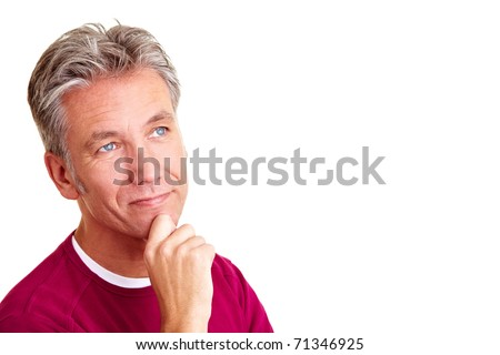 Pensive elderly man looking up thoughtfully with hand on chin - stock photo
