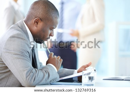 Pensive entrepreneur thinking over financial results - stock photo