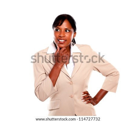 Pensive executive young female looking right against white background - stock photo