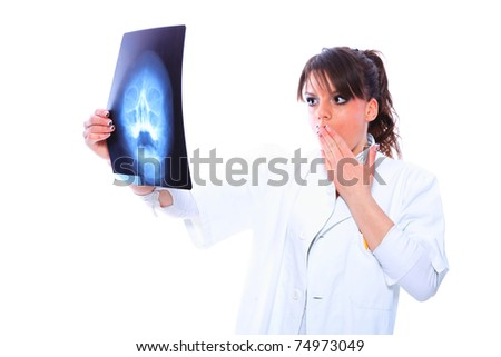 Pensive female doctor looking at the x-ray images.