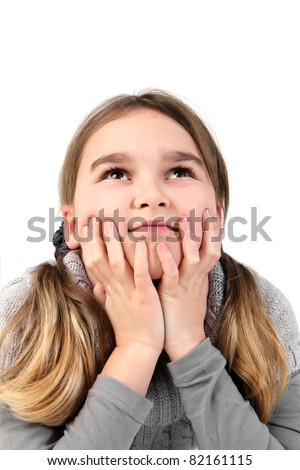 Pensive girl, her head leaning on the hands, studio shot against a white background. - stock photo