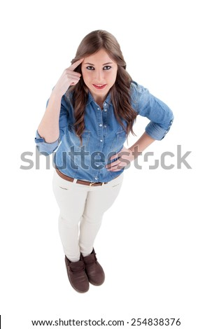Pensive girl pointing her head isolated on a white background - stock photo
