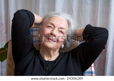 Pensive grandmother - stock photo