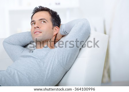 Pensive man on sofa