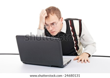pensive man with computer isolated in office