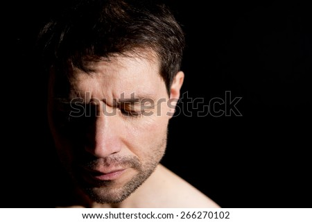 Pensive Man With Half Face In Shadow - stock photo