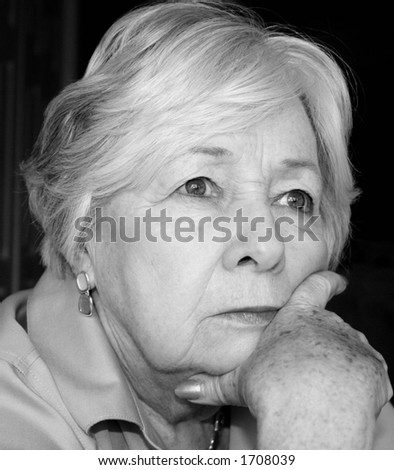 Pensive older woman in black and white - stock photo