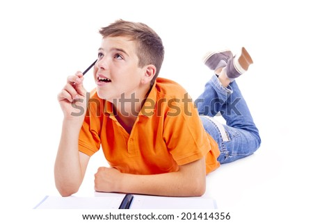 Pensive school kid looking up, isolated over white background - stock photo