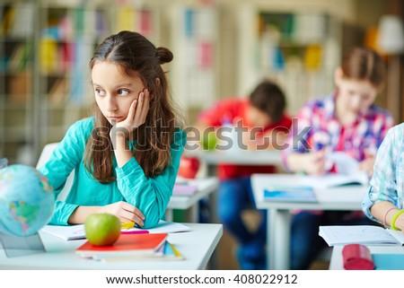 Pensive schoolgirl - stock photo